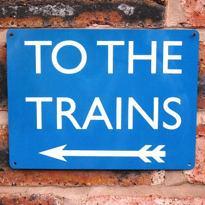 To The Trains Sign – Blue Left Arrow