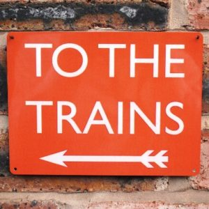 To The Trains Sign – Red Left Arrow